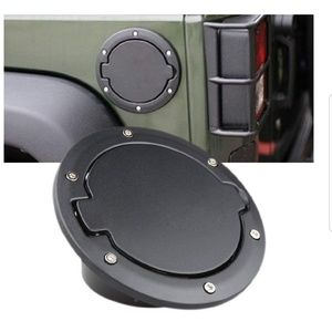 Black jeep gas cover with silver bolts